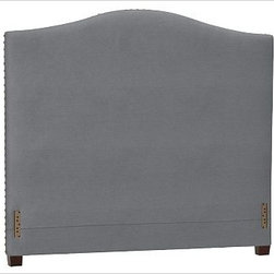 """Raleigh Nailhead Camelback Headboard, Cal. King, Twill Metal Gray - Crafted by our own master upholsterers in the heart of North Carolina, our upholstered bed and headboard is available in a graceful camelback silhouette. Crafted with a kiln-dried hardwood frame. Headboard, footrail and siderails are thickly padded and tightly upholstered with your choice of fabric. Nailhead detail trims the outer edges of the headboard. Exposed block feet have a hand-applied espresso finish. Headboard also available separately. The headboard-only option is guaranteed to fit with our PB metal bedframe using the headboard hardware. Bed is designed for use with a box spring and mattress. This is a special-order item and ships directly from the manufacturer. To see fabrics available for Quick Ship and to view our order and return policy, click on the Shipping Info tab above. This item can also be customized with your choice of over {{link path='pages/popups/fab_leather_popup.html' class='popup' width='720' height='800'}}80 custom fabrics and colors{{/link}}. For details and pricing on custom fabrics, please call us at 1.800.840.3658 or click Live Help. View and compare with other collections at {{link path='pages/popups/bedroom_DOC.html' class='popup' width='720' height='800'}}Bedroom Furniture Facts{{/link}}. Crafted in the USA. Full: 57.5"""" wide x 83.5"""" long x 59"""" high Queen: 64.5"""" wide x 88.5"""" long x 59"""" high King: 80.5"""" wide x 88.5"""" long x 59"""" high Cal. King: 74.5"""" wide x 92.5"""" long x 59"""" high Full: 57.5"""" wide x 4.5"""" thick x 59"""" high Queen: 64.5"""" wide x 4.5"""" thick x 59"""" high King: 80.5"""" wide x 4.5"""" thick x 59"""" high Cal. King: 74.5"""" wide x 4.5"""" thick x 59"""" high"""