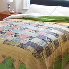 Kantha Quilt - Lime/Multi - Hand stitched in the Kantha style to create a stunning texture and appearance. This pretty bedspread with its vintage floral patchwork design is lined with a plain coordinating fabric. Because each one of these striking bedcovers is lovingly handcrafted every one is unique.
