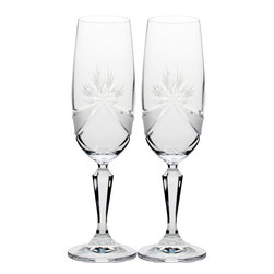 Martinka Crystalware & Lifestyle - Madame Royale Toasting Flute - The Madame Royale Toasting Flute makes a wonderful centerpiece. It's simple form and shape is adorned in regal dress which is designed from a combination of matte crystal and hand cut patterns. Two matte crystal sashes link together hand crafted floral patterns on both sides of the champagne flutes. Though intricate and elegant in design, the Madame Royale Toasting Flute is perfect for any occasion.