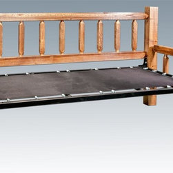 Montana Woodworks - Day Bed in Stained and Lacquered Finish - Mattress not included. Handcrafted with heirloom quality. Sawn squared timber and trim pieces. Must be finished with quality finish to prevent discoloration or damage. Durable and fit with rustic features. Personally signed by artisans. Mortise and Tenon joinery style. A+ rating fron BBB. Made from solid US grown wood. Ready to finish. Made in USA. 87 in. L x 46 in. W x 48 in. H (170 lbs.). Use and Care Instructions. Assembly Instructions. Finish Detail. WarrantyHomestead Collection of fine rustic furniture features timbers and trim pieces similar reminiscent of a timber framed home on the American frontier..From Montana Woodworks, the largest manufacturer of handcrafted quality log furnishings in America comes the all new Homestead Collection line of furniture products. The artisans rough saw all the timbers and accessory trim pieces for a look uniquely reminiscent of the timber-framed homes once found on the American frontier. This classic day bed with pop up trundle mechanism provides the customer with a robust and rustic platform on which they can rely for years of trouble free use