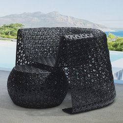 Black Lace Outdoor Lounge Chair - The Black Lace outdoor lounge chair is made of a snowflake wicker weave pattern. A matching ottoman is included.
