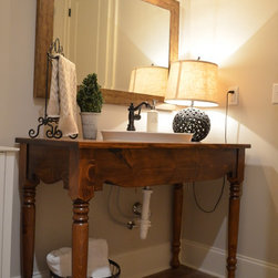 Country Vanity - Cute classy vanity definitely lightens the room with this furniture look. This is a great way to add in your own decorative style without the box look of a cabinet.