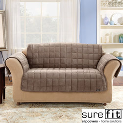 Sure Fit - Deluxe Sofa Comfort Cover - This 100 percent polyester sofa seat cover offers the perfect way for pet owners to protect their furniture. Odor resistant and machine washable for easy care, this sofa cover will protect your upholstery while providing superior comfort.
