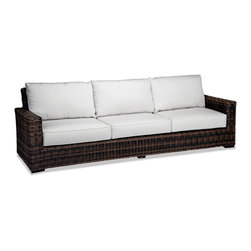 Thos. Baker - Wicker Outdoor Large Sofa | Hampton Java Collection - Our most popular over-sized wicker collection is now available in a rich java color weave. Premium, dyed-through resin wicker with an extra large diameter profile and a rich variegated rustic finish. Powder-coated aluminum sub-frame and brushed aluminum feet.Plush Sunbrella cushion sets included where applicable. Choose quick ship in khaki with cocoa piping, stone green or choose from our made-to-order fabric options.Made-to-order cushion sales are final and ship in 2-3 weeks.