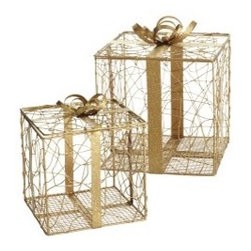 Gold Gift Boxes - From real gifts to fake ones, these affordable gold gift boxes from Pier 1 are the perfect addition to a corner or vignette that needs a little holiday help.