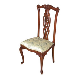 Mahogany Queen Anne Sage Floral Occasional Side Chair - This is a gorgeous mahogany Queen Anne style floral occasional side chair. The back has a very attractive carved top rail with foliage and scrolls and it features a gorgeous pierced splat with distinguished curved designs. There is a minor chip on top of its carved rail, but as shown it is not distracting at all and it can be repaired if necessary. The chair has a comfortable seat upholstered with a beautiful sage fabric that is adorned with lovely floral & instrument designs. The cabriole legs exemplify elegance. This chair is a showroom model and may have some minor imperfections but as shown it is overall in very good condition. It is shipped assembled. Sold as is. Whether added to an existing piece of furniture or standing alone this chair would be a lovely addition to any home.