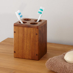 Teak Toothbrush Holder - Store toothbrushes handsomely in this Teak Toothbrush Holder, made of beautiful dark-brown hardwood. This unique tooth brush holder has a silky smooth finish.