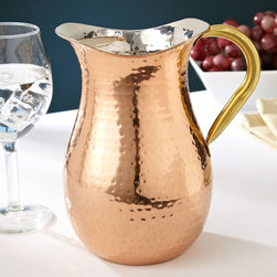 Hammered Copper Pitcher with Ice Guard - Add sparkle to the table with this beautiful copper pitcher, which seems reminiscent of something that might have been used at the very first Thanksgiving.