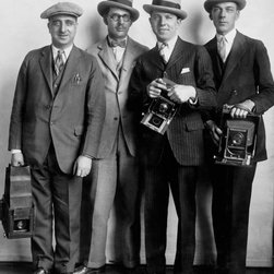 White House News Photographers 1920's Print - Group portrait of four members of the White House News Photographers' Association, standing, facing front, holding cameras. Created between 1922 and 1926 by the National Photo Company.