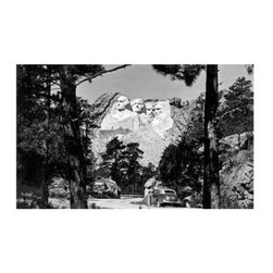 Artehouse Mt. Rushmore Art Print - 18W x 24H in. - North by Northwest. Mt. Rushmore is a vintage image of Mt. Rushmore that is of the era of the famous Alfred Hitchcock movie. This 24L x 18-inch high limited edition black and white photograph is printed on Somerset Velvet paper and comes ready for framing. Unique gift idea for Hitchcock fans!