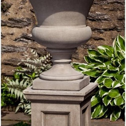 Campania International - Campania International Wilton Urn Planter with Barnett Pedestal - PPD-644-AL - Shop for Planters and Pottery from Hayneedle.com! The Campania International Wilton Urn Planter with Barnett Pedestal features a graceful urn basin for flowers and stands on a smart pedestal base. Perfect for your landscape design this two-piece set is as handsome as it is functional. Pieces are crafted of lightweight and durable cast stone that is a snap to move yet is durable enough to withstand the elements for years. Available in a variety of aged finish options. Campania Cast Stone: The ProcessThe creation of Campania's cast stone pieces begins and ends by hand. From the creation of an original design making of a mold pouring the cast stone application of the patina to the final packing of an order the process is both technical and artistic. As many as 30 pairs of hands are involved in the creation of each Campania piece in a labor intensive 15 step process.The process begins either with the creation of an original copyrighted design by Campania's artisans or an antique original. Antique originals will often require some restoration work which is also done in-house by expert craftsmen. Campania's mold making department will then begin a multi-step process to create a production mold which will properly replicate the detail and texture of the original piece. Depending on its size and complexity a mold can take as long as three months to complete. Campania creates in excess of 700 molds per year.After a mold is completed it is moved to the production area where a team individually hand pours the liquid cast stone mixture into the mold and employs special techniques to remove air bubbles. Campania carefully monitors the PSI of every piece. PSI (pounds per square inch) measures the strength of every piece to ensure durability. The PSI of Campania pieces is currently engineered at approximately 7500 for optimum strength. Each piece is air-dried and then de-molded by hand. After an internal quality check pieces are sent to a finishing department where seams are ground and any air holes caused by the pouring process are filled and smoothed. Pieces are then placed on a pallet for stocking in the warehouse.All Campania pieces are produced and stocked in natural cast stone. When a customer's order is placed pieces are pulled and unless a piece is requested in natural cast stone it is finished in a unique patinas. All patinas are applied by hand in a multi-step process; some patinas require three separate color applications. A finisher's skill in applying the patina and wiping away any excess to highlight detail requires not only technical skill but also true artistic sensibility. Every Campania piece becomes a unique and original work of garden art as a result.After the patina is dry the piece is then quality inspected. All pieces of a customer's order are batched and checked for completeness. A two-person packing team will then pack the order by hand into gaylord boxes on pallets. The packing material used is excelsior a natural wood product that has no chemical additives and may be recycled as display material repacking customer orders mulch or even bedding for animals. This exhaustive process ensures that Campania will remain a popular and beloved choice when it comes to garden decor.About Campania InternationalEstablished in 1984 Campania International's reputation has been built on quality original products and service. Originally selling terra cotta planters Campania soon began to research and develop the design and manufacture of cast stone garden planters and ornaments. Campania is also an importer and wholesaler of garden products including polyethylene terra cotta glazed pottery cast iron and fiberglass planters as well as classic garden structures fountains and cast resin statuary.