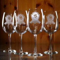 """Wine Glass Gifts,  Personalized Engraved Wine Glasses - The personalized shield and name banner wine glasses (set of 4) are a perfect gift idea for weddings, bridal showers, birthday, anniversaries, retirements and birthdays. Give our shield and banner wine glass to the couple who has everything and watch the smiles form on their faces! These monogrammed wine glasses are unlike any etched wine glass gifts you've ever seen. Deeply carved using our sand carving technique, each wine glass is meticulously custom made to order making it the perfect gift for those seeking unique gift ideas for wine lovers - men and women alike. At 9"""" high by 3.5"""" wide, our wine glasses hold 19 oz. A set of these etched wine glasses will be the favorite gift at any special gift giving occasion. Dishwasher safe."""