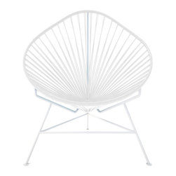 Acapulco Chair, White Frame - The vinyl cords in this chair make a comfy resting spot inside or outside of your home. The classic design is weather proof and easy to clean with just a wipe of a cloth or spray of the hose. Pick from a rainbow of colors or stick with the iconic black and white design and you can't go wrong.