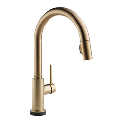 """Delta - Delta 9159T-CZ-DST Trinsic Series Deck-Mounted Pull-Down Kitchen Faucet - The Delta 9159T-CZ-DST is a Trinsic Series Deck-Mounted Pull-Down Kitchen Faucet. This deck-mounted pull-down kitchen faucet features a Two-Function pull-down spout sprayer, a solid brass fabricated body, and a single lever handle for precise temperature and volume control. This model has a 15-11/16"""" tall 9-1/2"""" long spout, and a Touch-Clean spray head that allows for less mineral build-up. Itcomes with a MagnaTite docking system, and dual integral check valves in the sprayer for less backflow. This faucet also comes with an optional 10-1/2"""" keyed escutcheon for an easier installation, and a 1.8 GPM flow rate. This faucet is ADA and CalGreen compliant, and it features Delta's Touch20 Technology for easy on/off functioning when you don't have hands to turn the handle. This model comes in a refined, Champagne Bronze finish."""