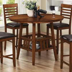 "Coaster - Knoxville Counter Height Table - The table in this set features an elegant round top and a storage base where you can display decorative pieces. The complementary counter height stools feature sleek legs and beautiful backs. Enjoy dinner with a few of your best friends using this five piece set.; Storage Space; Oak Finish; Country Style; Dimensions: 47.25""L x 47.25""W x 35.75""H"