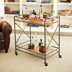 """New Products! - With our Kimber Bar Cart, you can take the party to the party. Clear, tempered glass shelves on top and bottom provide plenty of space for glassware and bottles. The simple elegant frame has """"X"""" details that add a dash of architectural style and strength. When mobile, gallery prevents glassware and items from shifting off glass shelves. Comes fully assembled."""