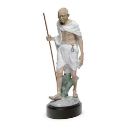 """Lladro Porcelain - Lladro Mahatma Gandhi Figurine - Plus One Year Accidental Breakage Replacement - """" Glazed porcelain in classical style. Astonishing is the perfect resemblance of the face, as a true portrait in porcelain. This political leader and Father of the Indian Nation is traditionally depicted walking forward, as a symbol of progress, evolution, movement, dynamic attitude, as well as allusion to the 1930 Salt March. He wears his most iconical attributes: the thin spectacles, indian dhoti trousers where an old pocket clock hangs plainly from a string, sandals and a bamboo cane.   Hand Made In Valencia Spain - Sculpted By: Javier Molina - Included with this sculpture is replacement insurance against accidental breakage. The replacement insurance is valid for one year from the date of purchase and covers 100% of the cost to replace this sculpture (shipping not included). However once the sculpture retires or is no longer being made, the breakage coverage ends as the piece can no longer be replaced. """""""