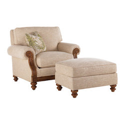 Lexington Home Brands - West Shore Chair with Ottoman - This Lexington Tommy Bahama arm chair and ottoman would be equally at home in an island villa or a sun room in suburbia.  Draped in a durable beige fabric with a smooth, slightly raised texture, fern fronds adorn the exposed wood and the turned feet complete the island feel. While supportive, the arm chair cushion is quite plush. Close your eyes, put your feet up, and picture yourself relaxing in this chair while sipping a cool drink and enjoying the peaceful breezes of an island getaway.
