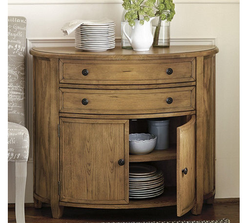 Ballard Designs - Brookfield Demilune - Crafted with solid wood frame & fine veneers. Antique brass finish pulls with beaded detail. We've lowered the price and added great new finishes to this gracefully bowed Ballard favorite. Perfectly scaled for a small entry or as a focal point at end of a hall. Two gently curved drawers and cabinet doors feature inset panels for a finely crafted look.Brookfield Demilune features: . .