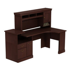 Bush - Bush Syndicate Expandable Corner Desk with Hutch in Harvest Cherry - Bush - Office Sets - SYN005CS - Syndicate fits comfortably in traditionally styled work environments no matter where they may be. Combining classic design elements its small footprints are appropriately scaled for serious home offices. Large small or any size space in between Bush Syndicate Line Harvest Cherry Expandable Corner Workstation with Overhead has plenty of storage and smart technology integration. Offers one box drawer for supplies one drawer for letter- legal- or A4-size files. All drawers open on fully extendable ball bearing slides for easy access to back. Single raised panel door conceals deep compartment for CPUs or other storage. Handy built-in charging station keeps cameras tablets and phones powered up but at your fingertips. Overhead Storage integrated open-and-closed cabinet has one raised panel door plus cubbies and cubicles to hold work in progress. Convenient angled shelf makes charging electronic devices neat and contained. Three open cubbies reduce desktop clutter storing papers books and more. Desktop and wire management grommets provide easy access to cords and cables. Solid sturdy laminate work surfaces look good for years and resist stains scratches abrasions and dents. Includes Bush 10-year warranty.
