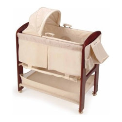 Contours Classique 3 in 1 Bassinet - Wherever you are in the house keep your newborn baby near with the Contours Classique 3-in-1 Bassinet. With a solid wood frame in a dark cherry finish this bassinet has a handsome appearance and it features a removable Moses basket so baby can sleep in any room. A self-storing changing table secures to the top of the bassinet rails and then hides away when not in use. On one end you'll find a deluxe organizer and diaper stacker so you're always ready when changing time calls. There's another large storage basket underneath for more of baby's must-haves. The bassinet features a padded quilted interior with mesh sides for increased air flow. This bassinet sits on casters that lock for safety and allow for easy portability. While this removable Moses basket and bassinet frame on wheels makes for easy mobility it is important that you never move or carry these pieces while baby is using them. About KolcraftStarted in 1946 when Leo Koltun began fashioning playpens out of cotton batting and oilcloth covers Kolcraft soon found itself designing all kinds of baby-geared items with simple ingenuity. Since 1951 Kolcraft has turned itself into the #1 crib mattress manufacturer and has forayed into plastic products such as infant carriers rockers high chairs and the like. Always at the forefront of innovation and safety starting in the 1990s Kolcraft began designing bassinets bouncers swings and juvenile furniture. The people at Kolcraft - which continues to be a family-owned business - are committed to the younger generation and making the process of raising kids an easier and more rewarding experience.