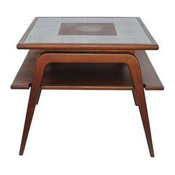 Pre-owned Mid-Century Side Table with Tile Top - A quintessential Mid-Century Modern side table. The ceramic tile bordered top perfectly compliments the solid walnut body and tapered legs of the table. Mix in this piece next to your modern sofa or bed for a hip and nostalgic effect.