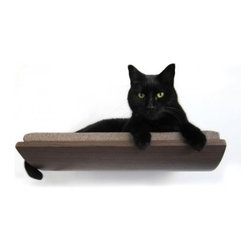 Curve Pet Bed - For those who insist their pets don't mess with the sleek lines of their minimalist abodes, there is an alternative to the fluffy, furry bed that lies on the floor. This version mounts on the wall, and while I'm not sure how your cat or dog gets up there (unless it's close to the floor), don't you think your little guy would make a neat wall hanging? This is also a great way to get texture into your space, unless you've got a Mexican hairless.