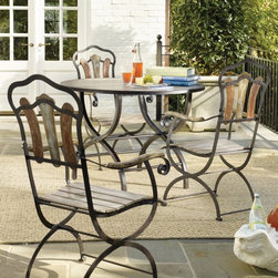 Hooker Furniture - Hooker Furniture Sanctuary 5 Piece 42 in. Multi-Color Round Metal Bistro Set Mul - Shop for Dining Sets from Hayneedle.com! Bring the relaxed atmosphere of alfresco dining into your home kitchen or dining room with the Sanctuary 5 pc. 42 inch Multi-Color Round Metal Bistro Set. This charming multi-colored set is highly durable and strikingly modern. You and your guests will enjoy the comfort of these four multi-colored chairs made from oak solids and sturdy metal that's fun and reliable. The table a 42-inch round piece provides more than enough space for all your dining needs and features a beautiful light-colored top that perfectly complements the dazzling colors of the chairs. Chairs measure 21W x 24D x 39H inches. Table measures 42L x 42W x 30H inches. Not intended for outdoor use.Not available for sale in or delivery to the state of California.About Hooker Furniture CorporationFor 83 years Hooker Furniture Corporation has produced high-quality innovative home furnishings that seamlessly combine function and elegance. Today Hooker is one of the nation's premier manufacturers and importers of furniture and seeks to enrich the lives of customers with beautiful trouble-free home furnishings. The Martinsville Virginia based company specializes in lifestyle driven furnishings like entertainment centers home office furniture accent tables and chairs. Construction of Hooker FurnitureHooker Furniture chooses solid woods and select wood veneers over wood frames to construct their high-quality pieces. By using wood veneer pieces can be given a decorative look that can't be achieved with the use of solid wood alone. The veneers add beautiful accents of color and design to the pieces and are placed over engineered wood product for strength. All Hooker wood veneers are made from renewable resources and are located primarily on the flat surfaces of the furniture such as the case tops and sides. Each Hooker furniture piece is finished using up to 30 different