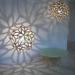 Floral Pendant - Floral Lamp series combines repeat patterned CNC cut plywood with a hint of Escher to produce a geometrically pleasing form, both pure in design and practical in purpose.