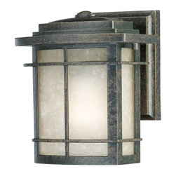 Quoizel - Galen Outdoor Wall Sconce by Quoizel - A warm look for Arts & Crafts exteriors. The Quoizel Galen Outdoor Wall Sconce features a sharp, intricate frame made out of durable cast aluminum. The dappled texture of the Imperial Bronze finish makes it the ideal complement to the similarly textural Umber Linen glass shade. For more than 80 years, Quoizel (based in Charleston, SC) has dedicated itself to bringing timeless lighting designs into modern homes. By consciously avoiding design fads, consistently balancing form and function and using only the highest quality materials, Quoizel lighting designs do indeed stand the test of time.