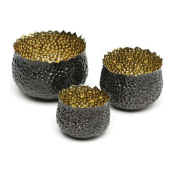 Bubble Brass Nesting Bowls, Set of 3 - Inspired by the brilliance of stars that illume an ink-black night, the Bubble Brass Nesting Bowls are formed and hammered by hand from solid brass. Polished to perfection on the inside, the bowl boasts a rich black matte finish on the outside. A dramatic addition to a dining table, sideboard, or generously sized accent shelf. Set of three.