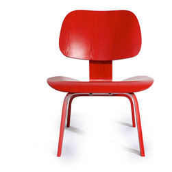 """Kardiel Plywood Chair, Red Stain - The original chair was designed using technology for molding plywood that the Eames developed before world war II. Charles and his friend, designer of the Womb Chair, Eero Saarinen entered the LCW (lounge chair wood) along with a variety of other pieces into the Museum of modern arts """"Organic Furniture Competition"""" in 1940. Charles and Eero won the competition. However, production of the initially designed chairs was postponed due to the United States entry into WWII. Our Eames Style Plywood Lounge chair (LCW lounge chair wood) reproduction has the good posture of civility and solid form, while feeling as familiar as an old friend, as it may remind you of your chair and desk in elementary school only much more comfortable. Leather black and white or brown or white 'cow hide' covers are available in addition to wood and are a whimsical, practical use of space. The curiously modernist design combined with the Pony Skin 'Western style' look will generate discussion and will encourage a re"""