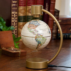 Floating Globe - This globe is suspended by magnetic fields so it's like a great looking magic trick on your desk. It's a great conversation starter for the office. It may look traditional but it's high tech.