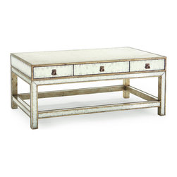 Silver-Eglomise Cocktail Table - Antiqued but urbane radiance gleams from every angle of this cocktail table.  Traditional in shape with its square braced legs, the low rectangular table brings your d�cor the timeless glamor of reflected light.   Its finish is a combination of silver leaf and eglomise, an old-world reverse gilding technique that results in the finesse of this rich mirrored effect.  Three drawers with drop handles provide storage under the lustrous surface.