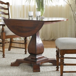 Waverly Place 42 in. Drop Leaf Pedestal Table - Looks so beautiful you may shed tears of joy, the Waverly Place 42 in. Drop Leaf Pedestal Table is as versatile as it is beautiful. The gorgeous cherry finish is complemented by a teardrop shape pedestal and foot base. The drop-leaf design ensures this table will fit in any space, and the classic round shape fits any decor style.Not available for sale in, or delivery to, the state of California.About Hooker Furniture CorporationFor 83 years, Hooker Furniture Corporation has produced high-quality, innovative home furnishings that seamlessly combine function and elegance. Today, Hooker is one of the nation's premier manufacturers and importers of furniture and seeks to enrich the lives of customers with beautiful, trouble-free home furnishings. The Martinsville, Virginia, based company specializes in lifestyle driven furnishings like entertainment centers, home office furniture, accent tables, and chairs.Construction of Hooker FurnitureHooker Furniture chooses solid woods and select wood veneers over wood frames to construct their high-quality pieces. By using wood veneer, pieces can be given a decorative look that can't be achieved with the use of solid wood alone. The veneers add beautiful accents of color and design to the pieces, and are placed over engineered wood product for strength. All Hooker wood veneers are made from renewable resources and are located primarily on the flat surfaces of the furniture, such as the case tops and sides.Each Hooker furniture piece is finished using up to 30 different steps, including 13 steps of hand-sanding and accenting. Physical distressing is done by hand. Pieces receive two to three coats of solid lacquer to create extra depth and add durability to the finish. Each case frame is assembled using strong mortise-and-tenon joints, which are then reinforced by mechanical fasteners and glue. On most designs, end panels extend to the floor to add strength and stability. Panel-style furniture features strong panel and frame construction to help avoid warping.Your Hooker furniture features finished case interiors to eliminate unsightly raw wood and to help protect items you may store inside drawers or cabinets. Drawer parts are given a urethane or lacquer finish to create smooth action and durability. All drawers use dovetails, either English or French, for years of problem-free use. Drawer bottoms are constructed from plywood and attached to the plywood drawer sides via the use of hot glue and/or wood glue blocks. Most drawers are full width, depth, and height to provide the maximum amount of storage space.