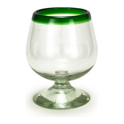 Bambeco Green Rim Recycled Cognac Glass - A colorful accent. A broad band of vivid green encircles the top of our Green Rim Recycled Cognac Glass. The ever-so-slight tint to the clear glass might remind you of bottles from a certain Atlanta-based soda company. And for good reason. These gorgeous pieces are created by skilled artisans using generations-old techniques to transform recycled soda bottles into sustainable treasures. Entirely handcrafted, each piece is a unique work of art to grace your table. Holds 16 ounces. Care: Dishwasher safe.Handcrafted in Mexico.Dimensions: 5.25H x 4W.