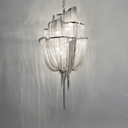 Terzani USA - Atlantis Three Tier Suspension - Atlantis three tier suspension features a handmade weave of delicate fabric created by illuminated lengths of draped nickel chain.  Available in Nickel, Black Nickel, Bronze and Gold finish.  Available in three sizes as well as two wall sconce versions, a two tier suspension and chandelier versions.  Large option is 35.4 inches wide x 28.7 inches deep x 80.8 inches high and requires eight 60 watt CA10 candelabra base incandescent lamps (not included).  Medium size option is 25.6 inches wide x 19.7 inches deep x 57.9 inches high and requires eight 60 watt CA 10 candelabra base incandescent lamps (not included).  Small option is 19.7 inches wide x 19.7 inches deep x 51.6 inches high and requires six 60 watt CA10 candelabra base lamps (not included).  ETL listed.  Designed by Barlas Baylar.