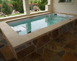 Endless Pools - 15' Endless Pool® Swim Spa - The giraffe-skin stone work around this Endless Pool Swim Spa brings a bit of the wild savanna to this open patio.