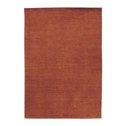 Couristan - Couristan Mystique Aura Area Rug - Burnished Rust Multicolor - 0596/0003-3.5X5.5 - Shop for Rugs and Runners from Hayneedle.com! The Couristan Mystique Aura Rug - Burnished Rust brings a dash of rich color to your home. The rust tone blends with most any type of decor. This loom-knotted rug is made of 100% wool and then luster-washed resulting in a 0.35-inch pile height. To preserve the beauty and color spot-clean as needed. Available in a variety of shapes and sizes this rug is made in India for Couristan Rugs. One-year limited warranty.Sizes offered in this rug:Following are all sizes for this rug. Please note that some may be currently unavailable due to inventory. Also please note that rug sizes may vary by up to 4 inches in dimensions listed.Dimensions:2 x 3 ft.2.6 x 4.2 ft.3.5 x 5.5 ft.4.1 x 7.1 ft.7.9 x 9.9 ft.2.2 x 7.9 ft. RunnerAbout Couristan RugsThe renowned Couristan Rug Company is headquartered in Fort Lee N.J. The company continues to take great pride in its 78-year-old commitment to excellence by weaving four key components - Trust Style Quality and Innovation - into each and every product it imports or manufactures. This commitment has earned the company a long-standing and successful position in the floor covering industry while providing its customers with the highest levels of design value and customer service.