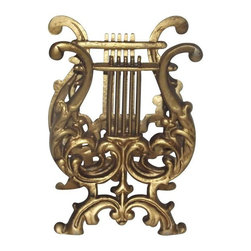 Pre-owned Vintage Lyre Shape Magazine Rack - A charming and unique lyre magazine rack for sale! It features a vintage gilt lyre shape with very intricate and ornate metal detail. This brilliant piece is sure to add the right touch of vintage to any home.