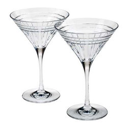 Reed & Barton - Tempo Crystal Martini Glasses - Wishing for a ripe olive to join in, the Tempo Martini Glass Pair from Reed & Barton mirrors the elegant simplicity of a well prepared cocktail. A statement of elegance, these striking crystal glasses boast a beautiful pattern that adds flawless refinement and style to any holiday cocktail party. * Set of 2 * Capacity: 8oz. * Made in Slovenia