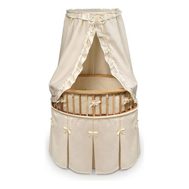 Badger Basket - Natural Elite Oval Baby Bassinet - Ecru Waffle Bedding - Sure to be used for all the babies in the family! Our Elite Bassinet in Ecru Waffle Bedding offers a traditional oval shape with a very upscale furniture look! Interior measures 32 in. L x 25 in. W x 7.5 in. H. Bedding set includes a skirt, padded bumper, fitted sheet, canopy, and mattress. Also includes caster wheels and storage shelf beneath. The Elite Bassinet can be used for infants up to 20 lbs or until Baby can push up/roll over. Easy assembly with illustrated instructions. Extra sheets also available in White and Ecru.