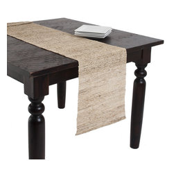 None - Woven Nubby Natural Table Runner - This table runner displays a natural aesthetic that works in traditional and modern decor. It is crafted from 100-percent ramie.