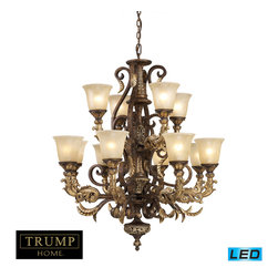 Elk Lighting - Regency LED 12-Light Chandelier in Burnt Bronze - Inspired by the scrolling design of the trump family crest, regency creates a rich and regal ambiance. The solid cast iron scrolls and burnt bronze finish compliments the delicate weathered gold leaf accents and caramel amber glass to create a dramatic and stunning collection. - LED's offering up to 9,600 lumens (720 watt equivalent) with full range dimming. Includes easily replaceable LED bulbs (120V).
