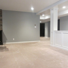Contemporary Basement by Marcusray Designs