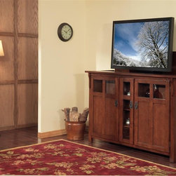 "Bungalow TV Lift Cabinet for flat screen TV's up to 55"" - The Bungalow combines Arts & Crafts design with flat screen LCD & Plasma technology. The rich chestnut hued Bungalow draws equally from Lodge and traditional Arts & Crafts influences. Rustic details including antique pulls and see-through boxed cutouts accentuate the gorgeous solid oak casing with oak veneers; perfect for displaying books, CDs, and DVDs. Arts & Crafts furniture's style and beauty are timeless. Made for plasma and LCD TVs up to 55"" wide by 32.5"" tall, the Bungalow utilizes whisper-lift technology for seamless operation. The three-sectioned interior arrangement offers multiple options for storage and display."