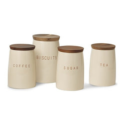 Bristol Canisters - I absolutely adore these functional and elegant canisters. The combination of dark wood and soft-colored ceramic lends such a welcoming look.