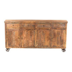 YOSEMITE HOME DECOR - Storage Console - This four door  rolling console rests upon four cast iron wheels. The solid mango cabinet features a soft textured finish with lite hand painted accents. A solid wood inner shelf along with the four drawers provides ample storage space. Assembled, Made in India.   Item Dimension are 80inches Widht X 14inches Depth X 40inches Height.