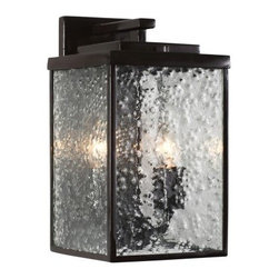 Varaluz Mission You 2-Light Outdoor Medium Wall Sconce - 6.88W in. Glossy Bronze - Mission style gets a mod makeover in the Varaluz Mission You 2-Light Outdoor Medium Wall Sconce - 6.88W in. Glossy Bronze - Clear Glass. You'll love how the hand-forged recycled steel body has a classic box shape, while the versatile glossy bronze finish creates a cool complement to the clear, raindrop-textured glass shade. You'll need to add two 100-watt medium base bulbs. UL and CUL listed for damp locations.About Varaluz:Committed to preserving the earth, Varaluz creates products from reclaimed and recycled materials. Most of their lighting fixtures are made from steel containing 70% or greater recycled content, and 100% recycled glass. This practice helps cut down on manufacturing waste, giving you peace of mind when installing their fixtures in your home.