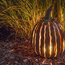 Desert Steel Pumpkin Luminary - Light up the autumn evening for years to come with this versatile Pumpkin Luminary. Maintenance free and rust resistant, the striking two-toned powder coat appears to glow from within when lit with a candle or light. Path, patio, porch or centerpiece celebrate Fall with one of nature's most iconic figures.